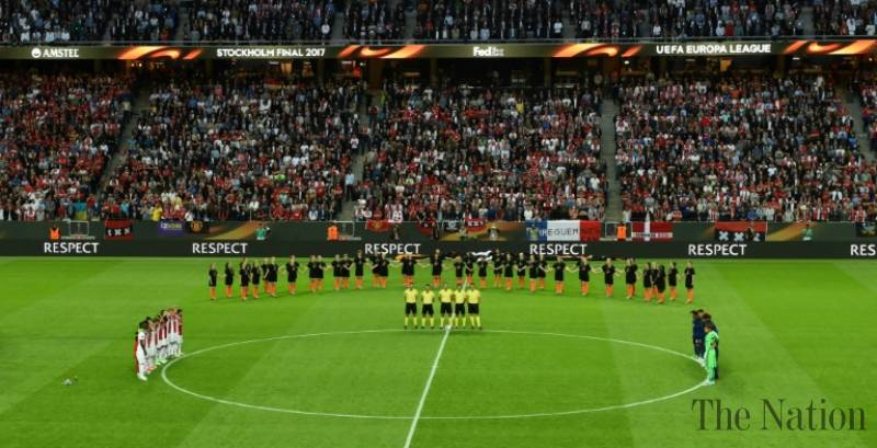 Silence, applause as Man Utd and Ajax honour Manchester victims