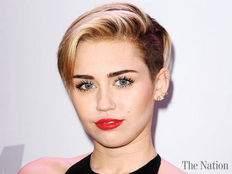 Miley supports Dolly Parton's charity
