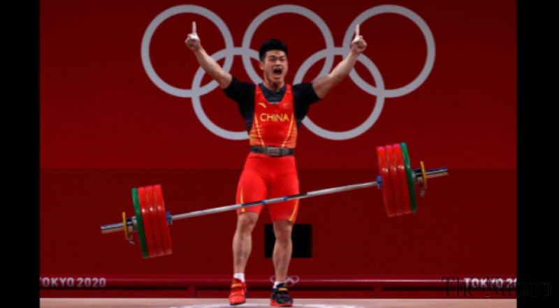 China's Shi Zhiyong breaks weightlifting record, wins Olympic gold