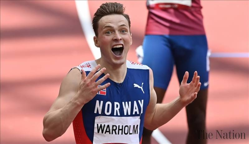 Warholm wins Olympic gold in men's hurdles, breaking own world record