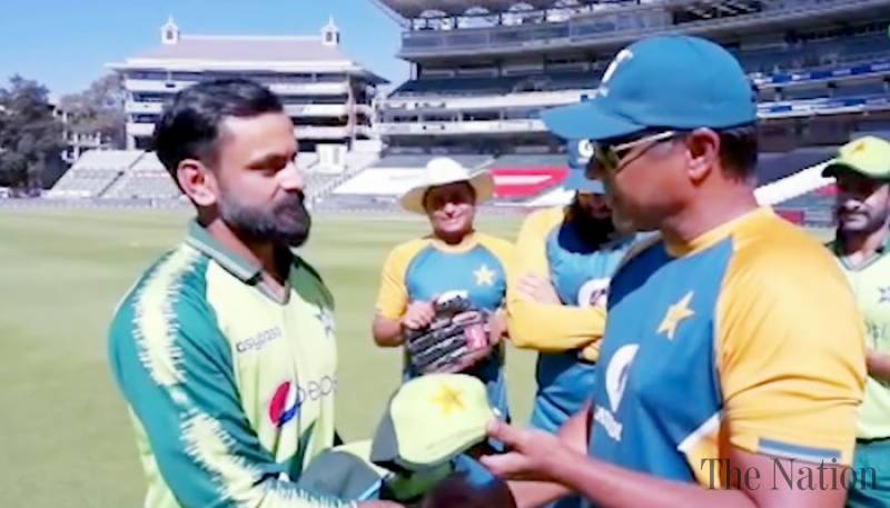 Hafeez receives 100th T20I cap from coach Waqar