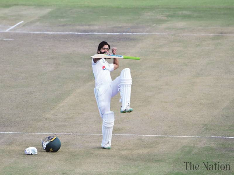 Fiery Fawad century helps Pakistan build big lead on day two